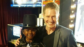 Tristan Crist poses with a young magician.