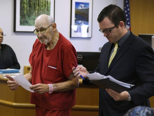 Thomas Emery, left, leaves court with his attorney,