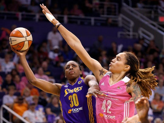 Phoenix Mercury's Brittney Griner (42) moves in to block the shot of Los Angeles Sparks's Nneka Ogwumike (30) during the second half of a WNBA basketball game on Tuesday, July 29, 2014, in Phoenix. The Mercury defeated the Sparks 90-69, winning their 16th straight game. (AP Photo/Ross D. Franklin)
