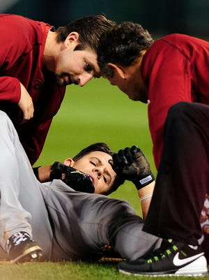 May 27, 2015: Arizona Diamondbacks catcher Tuffy Gosewisch (9) is looked at by trainers after running to first during the sixth inning against the St. Louis Cardinals at Busch Stadium. The Cardinals defeated the Diamondbacks 4-3.