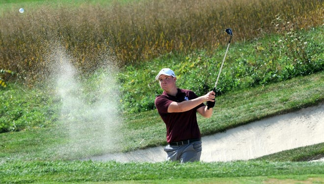 Dylan Van Fossen, of John Glenn, blasts out of a bunker on the 13th hole during the Division II state tournament in 2016 at Ohio State's Scarlet Course. Van Fossen on Monday said he will play at Toledo.