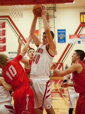 Dane Holmes pulls down  one of his nine rebounds for Twin Lakes.
