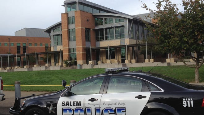 A Salem Police car sits out front of West Salem High School Tuesday morning.