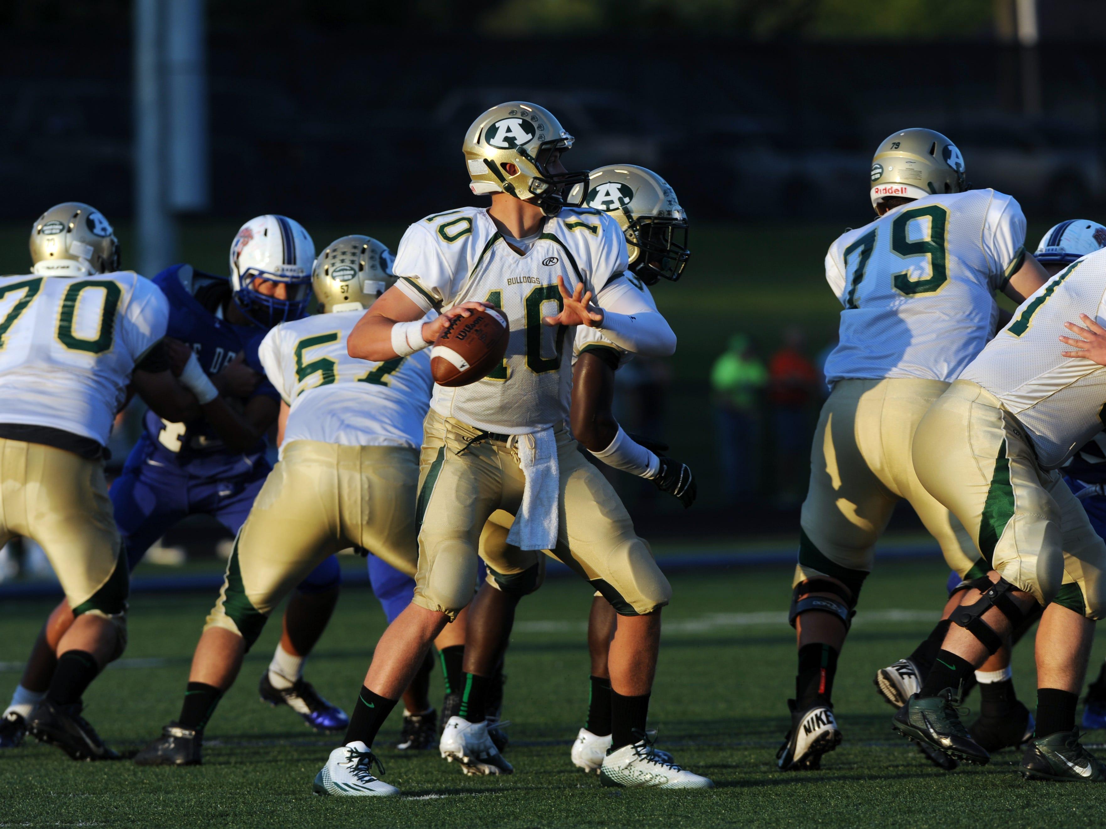 Athens' Joe Burrow, an OSU recruit, readies a throw against Zanesville.
