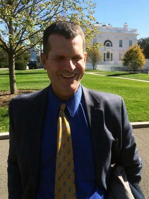 Michigan football coach Jim Harbaugh met with President Barack Obama at the White House Monday — and got condolences on a heartbreaking loss on Saturday from the First Fan, who watched the game against Michigan State.
