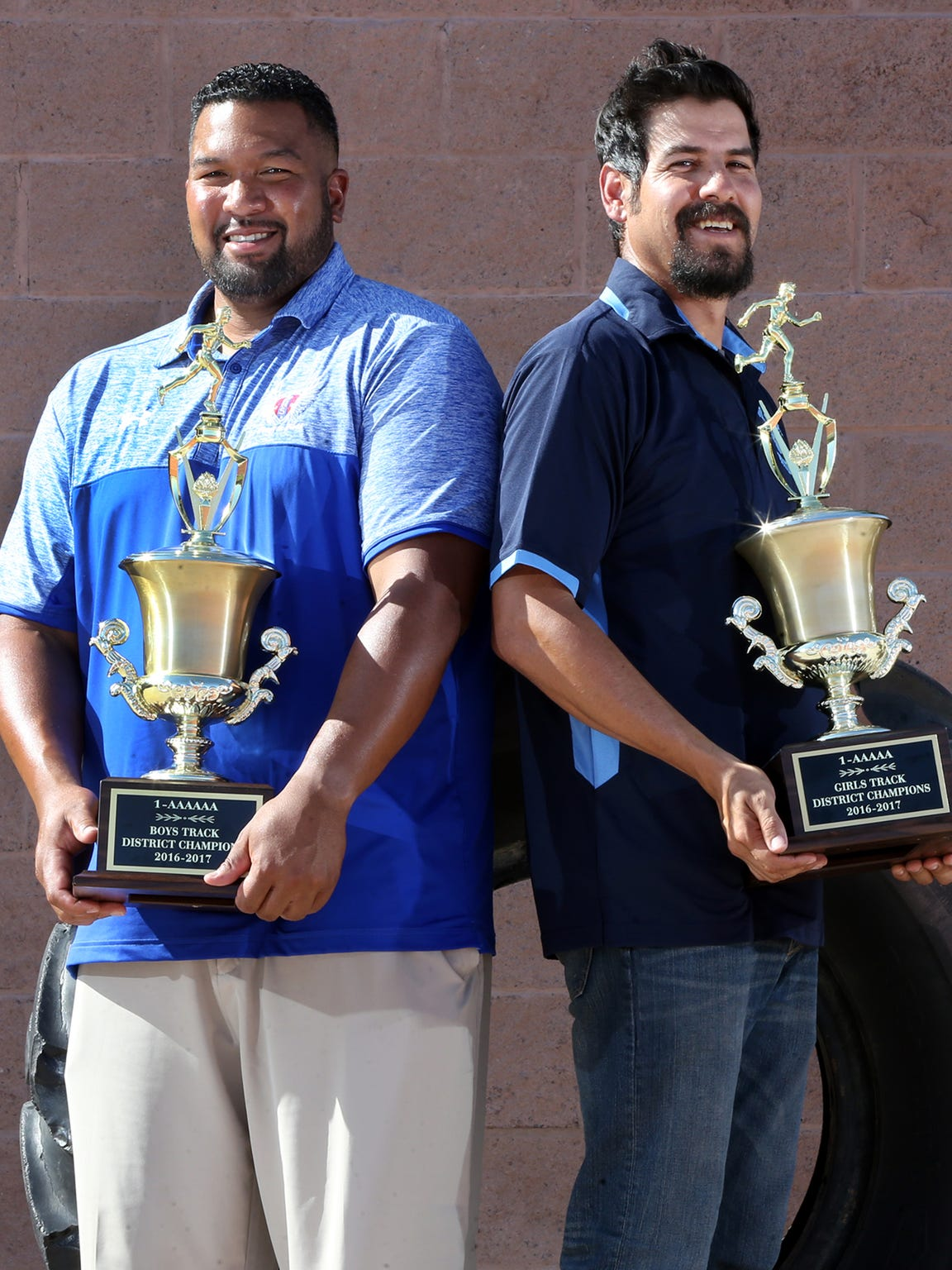 Menson Holloway, left, Americas High School boys coach and Mario Gomez, Chapin girls coach are the All-City Track and Field Coaches of the Year.