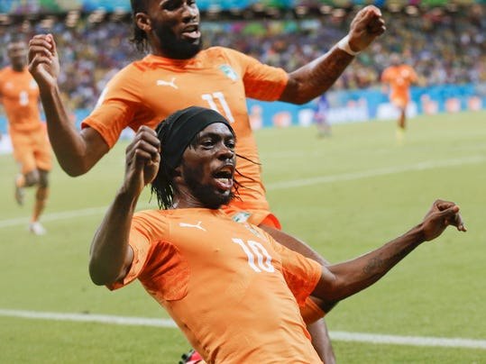 Ivory Coast's Gervinho (10) celebrates along with teammate Didier Drogba (11) after Gervinho scored his side's second goal during the group C World Cup soccer match between Ivory Coast and Japan at the Arena Pernambuco in Recife, Brazil, Saturday, June 14, 2014. (AP Photo/Petr David Josek)