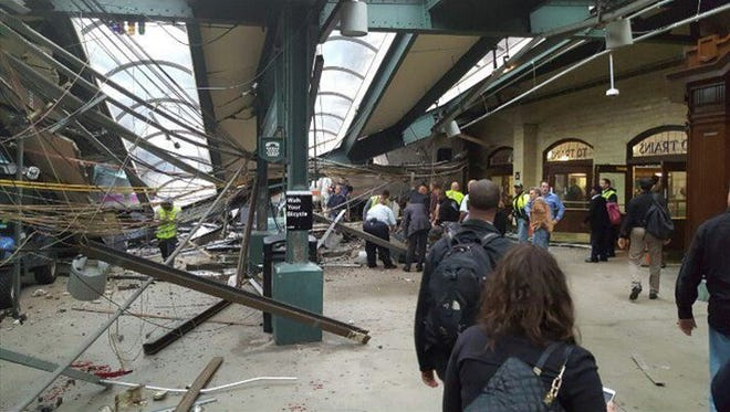 This photo provided by Ian Samuel shows the scene of a train crash in Hoboken, New Jersey, on Thursday, Sept. 29, 2016. A Pascack Valley Line commuter train barreled into the New Jersey rail station during the Thursday morning rush hour, causing multiple injuries and serious damage. The train came to a halt in a covered area between the station's indoor waiting area and the platform. A metal structure covering the area collapsed.