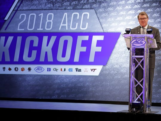 Atlantic Coast Conference commissioner John Swofford speaks during a news conference at the ACC NCAA college football media day in Charlotte, N.C., Wednesday, July 18, 2018. (AP Photo/Chuck Burton)