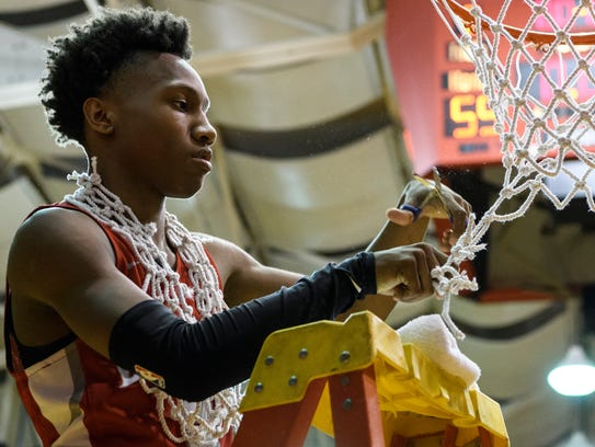 Bosse's Mekhi Lairy (2) cuts off a piece of the net