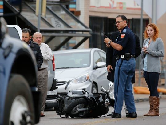 An unidentified scooter driver traveling along Texas Avenue ran into the back of a car and was injured, authorities and witnesses said. Witnesses said that the scooter driver attempted to go around the car when the driver applied her brakes and the scooter ran into the vehicle. Emergency responders and investigators look around as traffic continues to pass by the scene. The woman with her hands clasped is the driver of the car that the scooter ran into, police said. She reportedly was not injured. The driver of the scooter was transported to University Medical Center of El Paso with some injuries.