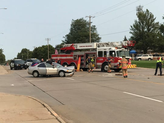 Officers and firefighters respond to a collision on