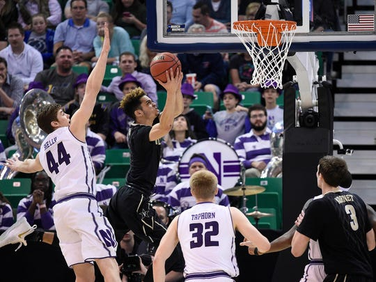 Vanderbilt guard Matthew Fisher-Davis (5) moves to the basket against Northwestern's   Gavin Skelly (44) and Nathan Taphorn (32) during the first half in the NCAA tournament first round game in Salt Lake City  on March 16, 2017.