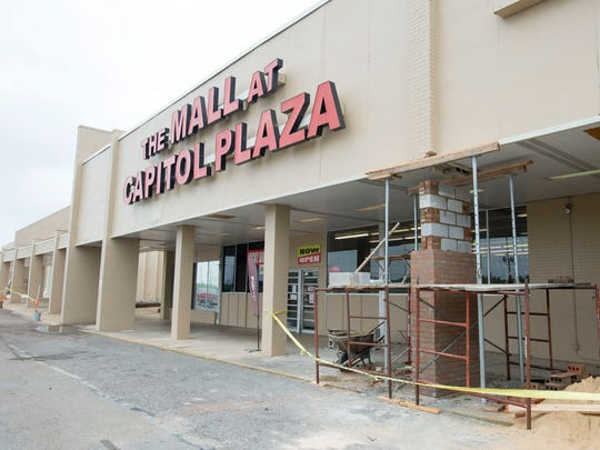 Workers continue improvements to Capitol Plaza Shopping Center Friday, June 22, 2018, in Montgomery, Ala. A group of investors from Dallas, Texas, recently purchased the center.