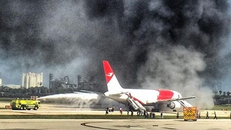 A Dynamic Airways passenger jet caught fire as it was taxing at Fort Lauderdale-Hollywood International Airport, releasing large plumes of black smoke on Thursday, Oct. 29, 2015.