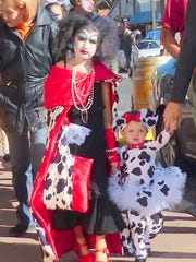 A Dalmatian duo out shopping for candy