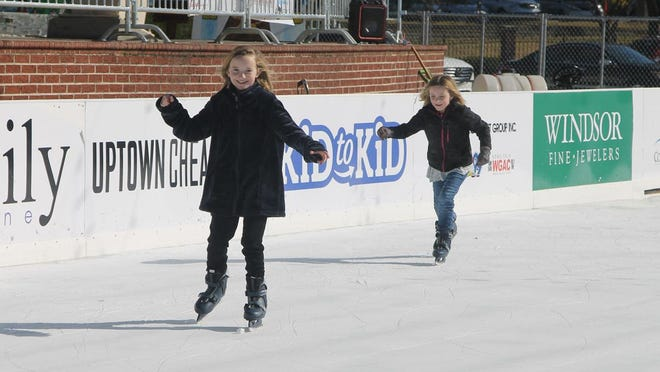 Sisters Anna Blair Hopkins and Ava Lyn Hopkins skate during the 2018 Christmas in Columbia County celebration.