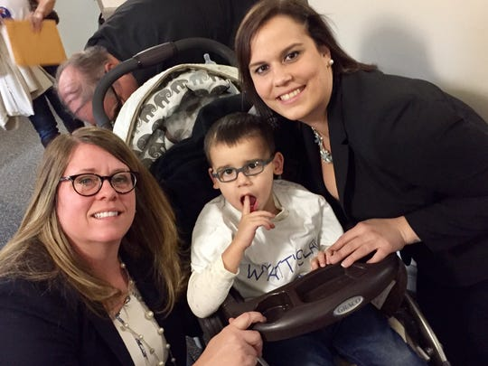 State Rep. Sarah Roberts, D-St. Clair Shores, poses for a photo Wednesday, Nov. 30, with Wyatt Rewoldt and his mother, Erica Hammel.