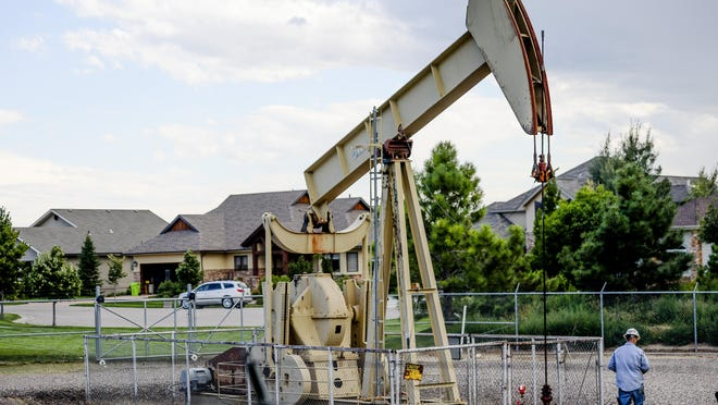 Larimer County officials will conduct public hearings on proposed regulations for oil and gas facilities in unincorporated parts of the county. Pictured is an oil pump in the Heathfire subdivision in the northeast part of Fort Collins.