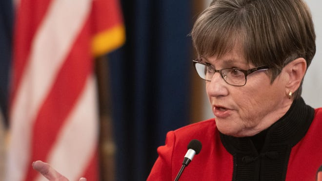 Gov. Laura Kelly talks about an increase in the spread of COVID-19 cases as well as the departure of Delia Garcia, former Kansas secretary of labor, during a news conference Monday at the Statehouse.