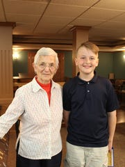 Agnes, Felician Village resident, and Bradin, St. Francis of Assisi student, were pen pals since December and enjoyed meeting for the first time.