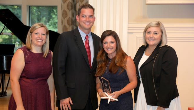Dr. Russ and Tenille Rauls were named the North Central Arkansas Foster Parents of the year for 2018 at a recent ceremony. Pictured are: (from left) DCFS Director Mischa Martin, Dr. Russ Rauls, Tenille Rauls and DCFS Foster Care Manager Tiffany Wright.