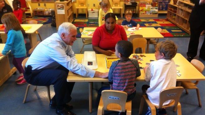 Gov. Mike Pence, seen here visiting a local preschool, pushed a preschool pilot program through the state legislature in 2014.