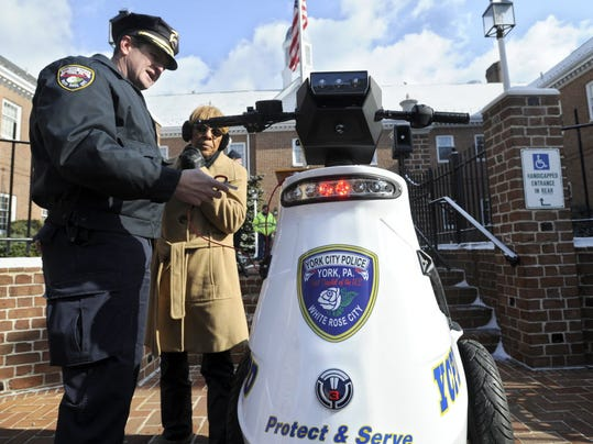 In this 2013 photo, then York City Police Captain Russell Tschopp explains the T3 Patroller Unit to York City Council President Carol Hill-Evans. Tschopp, now retired, has been charged with collecting $1,000 in city funds over three years for a college degree that he did not earn, according to court records filed Tuesday.