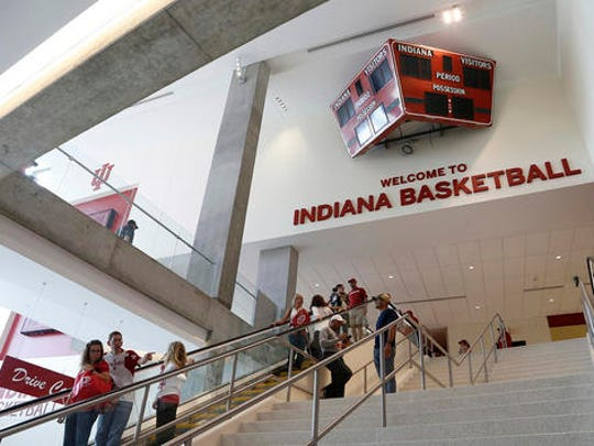 Fans walk through renovated Assembly Hall in Bloomington, Ind., Saturday, Oct. 15, 2016. On the north end, the feature attraction is the hanging midcourt section from the playing floor used at from Assembly Hall from 1976-95. Look around and fans will find the scoreboard that hung above center court from 1983-2005 and the double-sided stanchions that were once a signature part of Indiana basketball. (AP Photo/Sam Riche)