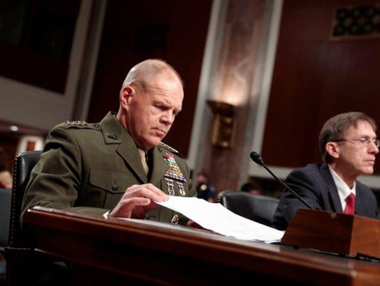 Marine Corps Commandant Gen. Robert B. Neller, left,