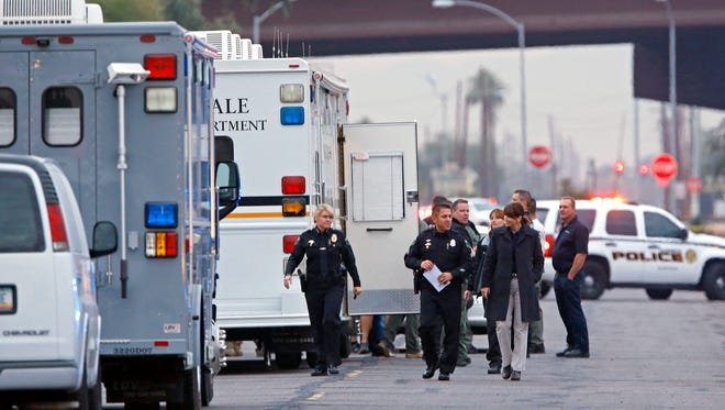 Glendale police work a barricade situation at the post office along 51st Avenue Tuesday, Dec. 2, 2014 in Glendale, Ariz.