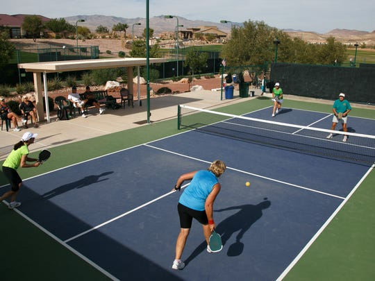 SunRiver residents Sarah Gaines and Yvonne Hackenberg play Marilyn Eves and Pam King, from right, in a game of doubles pickleball Thursday, Oct. 23, 2014 on the courts a the SunRiver Community Center in St. George.