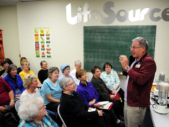 Alex Beamer, owner of LifeSource Natural Foods, welcomes people during a Taste of Oregon cooking class on Flavorful Soups.