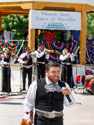 J.J. Unribe of the El Paso Mariachi group Tapoatio performs at the grand finale of the International Mariachi Conference Sunday afternoon on the square in Mesilla.