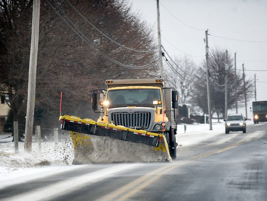 A plow pushes wind blown snow off the Heidelberg Ave. near Schaefferstown Thursday afternoon.