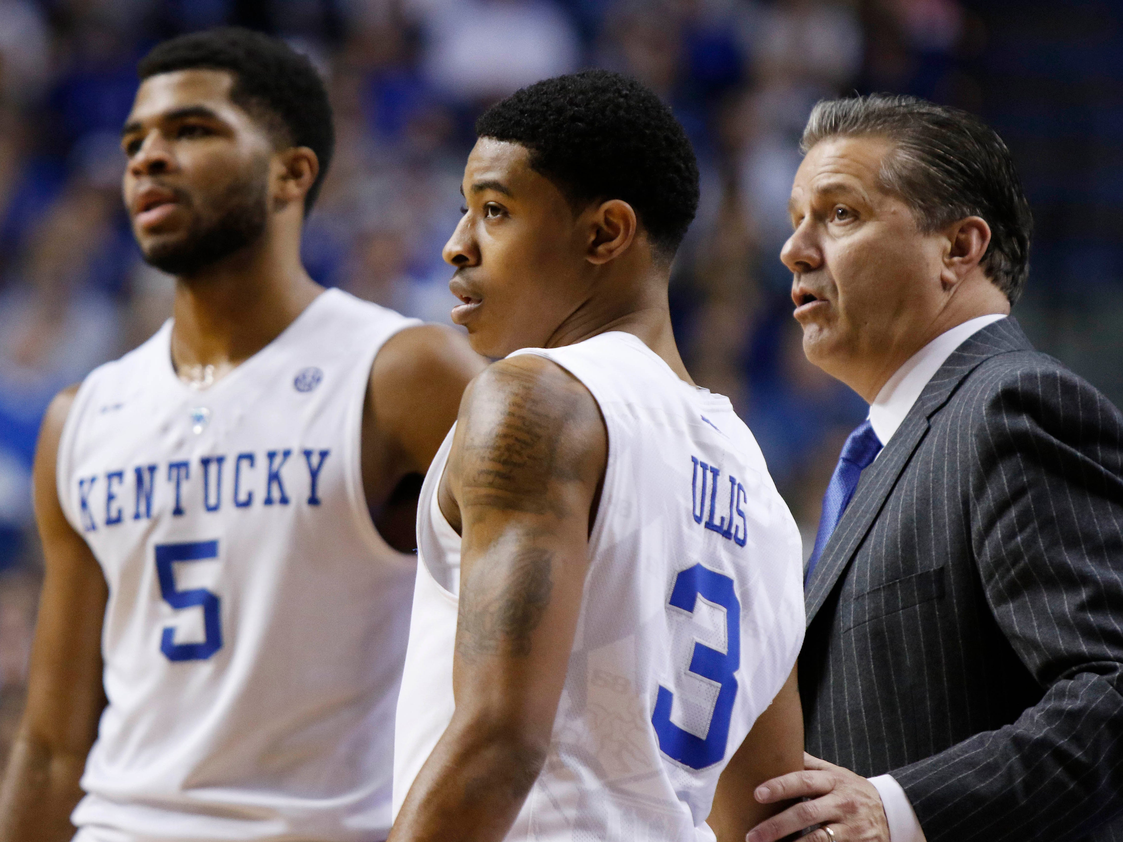 Kentucky head coach John Calipari, right, instructs Andrew Harrison (5) and Tyler Ulis (3) during the second half of an NCAA college basketball game against South Carolina, Saturday, Feb. 14, 2015, in Lexington, Ky. Kentucky won 77-43. (AP Photo/James Crisp)