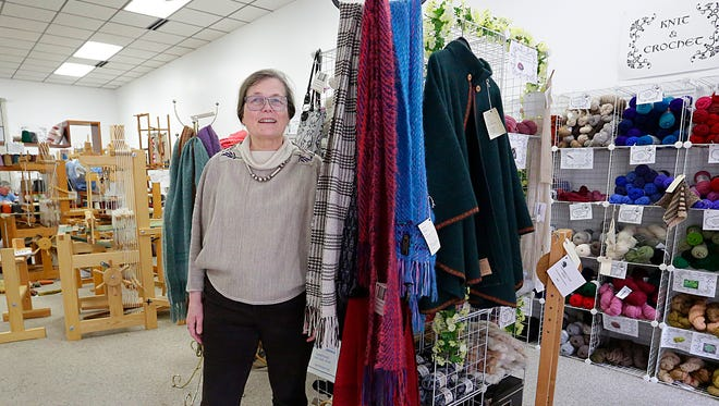 Sara von Tresckow stands next to some of her work at her store The Woolgatherers Ltd. on North Main Street.