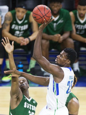 FGCU's Marc-Eddy Noreila scores against Stetson during the men's A-Sun final Sunday at Alico Arena in Fort Myers.