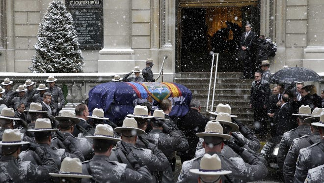 A casket containing the body of former New York governor Mario Cuomo is carried into Church of St. Ignatius Loyola for his funeral in New York, Tuesday, Jan. 6, 2015. Cuomo, 82, died in his Manhattan home on Jan. 1, hours after his son Gov. Andrew Cuomo was inaugurated for a second term.
