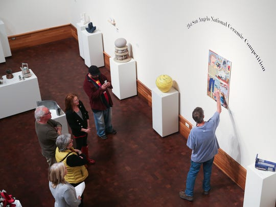 Visitors listen to Roger Allen, director of the Old Chicken Farm Art Center, talk about technique April 18, 2016, at the San Angelo National Ceramic Competition at the San Angelo Museum of Fine Arts, 1 Love St.