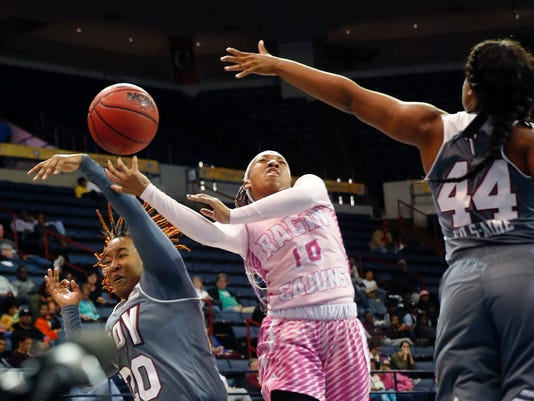 Louisiana-Lafayette guard Troi Swain (10) battles under the basket with Troy guard Ta'Kierra Gibbs (20) and forward La'Tia Fils-Aime' (44) during the first half of an NCAA college basketball game for the Sun Belt tournament title in New Orleans, Sunday, March 12, 2017. (AP Photo/Gerald Herbert)