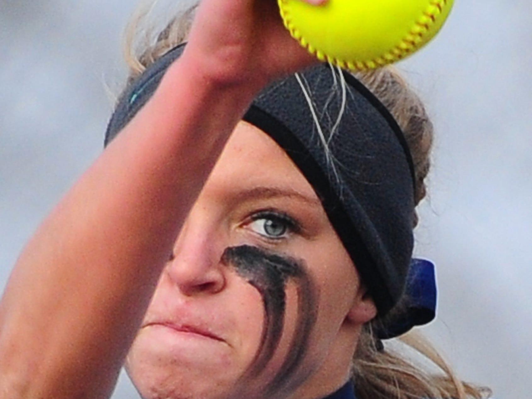 Bay Port pitcher Bailey Smaney winds up against Pulaski in a FRCC softball game at Bay Port High School, Thursday, April 17, 2014. H. Marc Larson/Press-Gazette Media