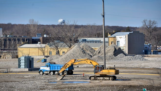 A truck and backhoe are parked on the former Verso Paper site, shown Friday, Feb. 26, 2016.