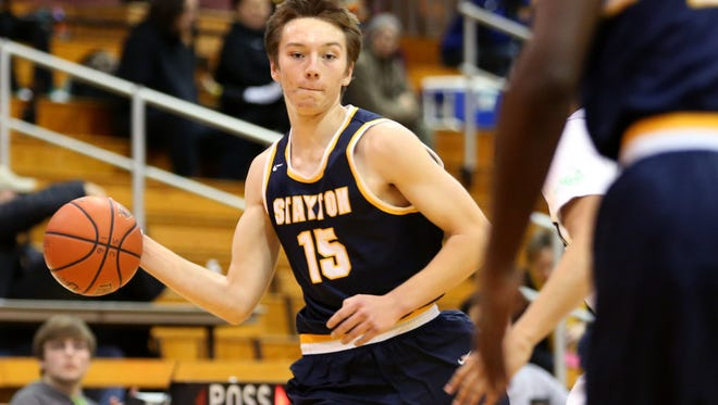 Stayton's Riley Nichol (15) moves with the ball in the Stayton vs. Seton Catholic boy's basketball game on the first day of the Capitol City Classic tournament at Willamette University in Salem on Wednesday, Dec. 21, 2016. Stayton won the game 62-58.