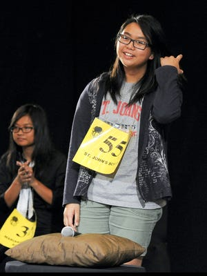 St. John's School eighth-grader Veronica Chua, right, lets out a sigh of relief after being declared the winner of the 2013 Scripps Regional Spelling Bee at the Sheraton Laguna Guam Resort in Tamuning on March 9, 2013. Rick Cruz/Pacific Daily News/rmcruz@guampdn.com