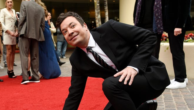 Jimmy Fallon, the host of the 74th annual Golden Globe Awards, makes sure the carpet in front of the Beverly Hilton is ready to go for Sunday.