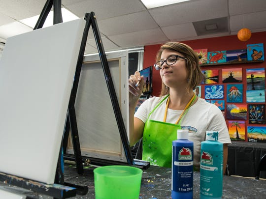Alexandra Jacobs paints a picture at OC Painting Experience brought to you by T.C. Studios on Tuesday, Aug. 15, 2017.