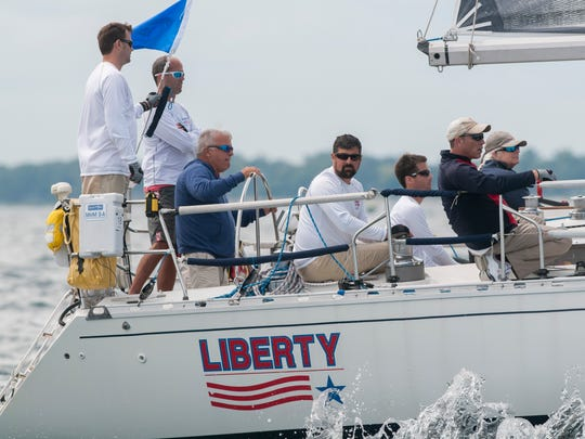 Bob Bert stands at the wheel of Liberty, of the Port Huron Yacht Club, as they travel up the lake Saturday, July 16, 2016 during the start of the Port Huron-to-Mackinac Island Sailboat Race in Class E.