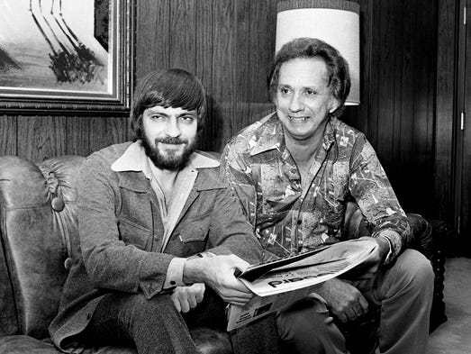 Songwriters Bobby Braddock, left, and Curly Putman