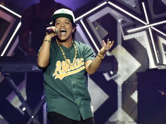 "Bruno Mars' ""24K Magic"" record and album are among"